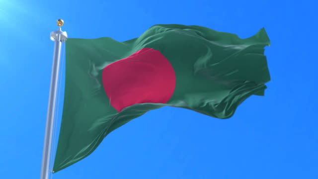 Bangladesh flag waving at wind in slow with blue sky, loop video