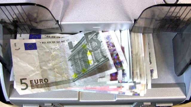 bankschalter-maschine - euros cash stock-videos und b-roll-filmmaterial