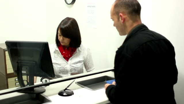 Bank - Handing out a form / paperwork video
