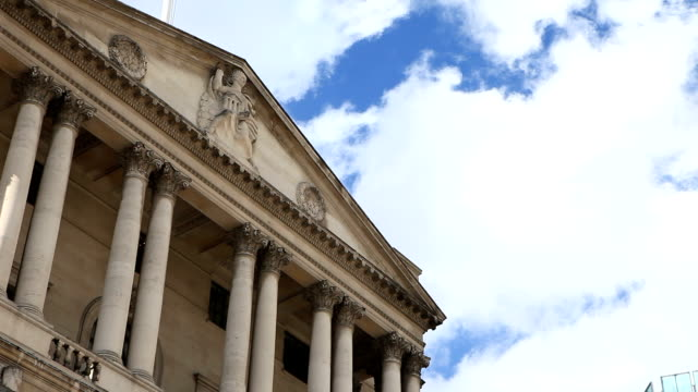 Bank of england The Bank of England front view against a cloudy sky, starts sunny goes moody. treasury stock videos & royalty-free footage