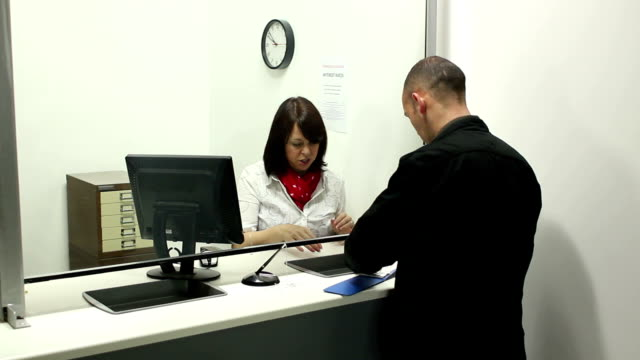 Bank  - Paying / counting money in pounds video
