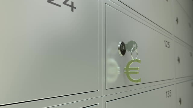 Bank safe deposit boxes and the key with euro sign keychain. Shallow focus FullHD dolly clip video
