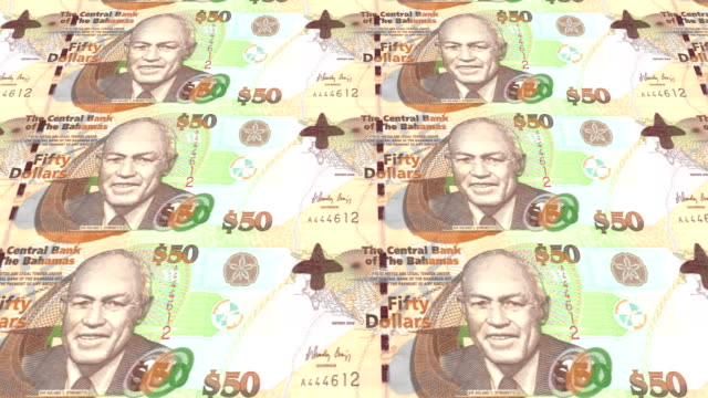 Banknotes of fifty bahamians dollars rolling on screen, cash money, loop video