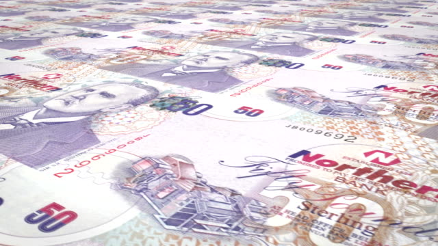 Banknotes of fifty pounds of Northern Ireland rolling, cash money video