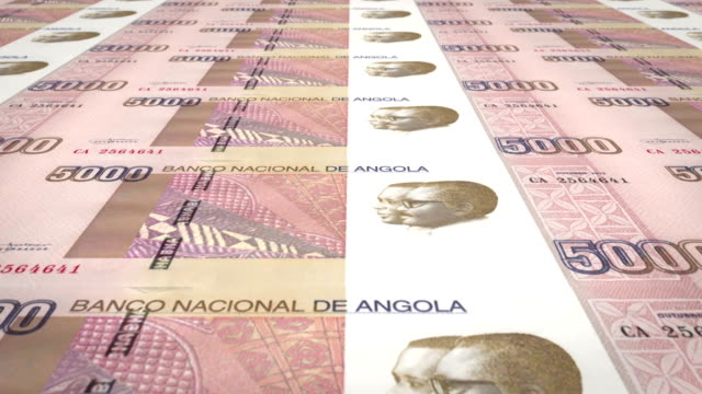 Banknotes of five thousand angolan kwanza of the central bank of the Republic of Angola rolling on screen, coins of the world, cash money, loop video