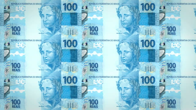 Banknotes of one hundred brazilian reals rolling on screen, cash money, loop video