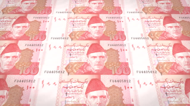 Banknotes of one hundred Pakistani rupees of Pakistan rolling, cash money, loop video