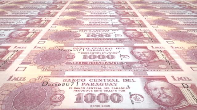 banknotes of one thousand paraguayan guarani of paraguay, cash money, loop - парагвай стоковые видео и кадры b-roll