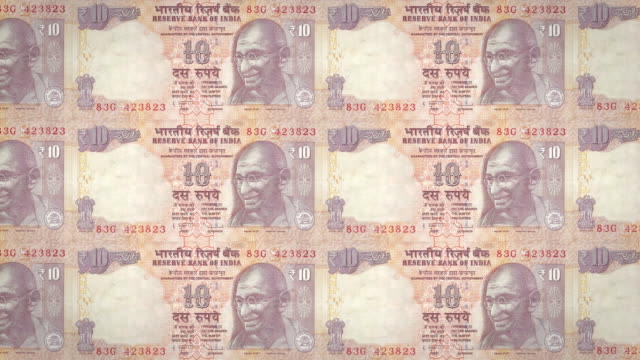 Banknotes of ten indian rupees of India rolling, cash money, loop video