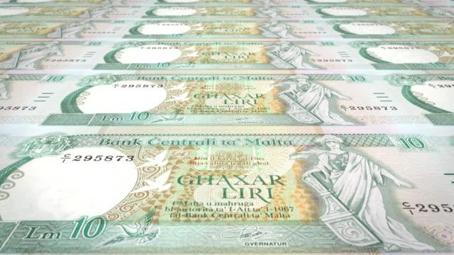 Banknotes of ten maltese liras or liri of Malta, cash money, loop video