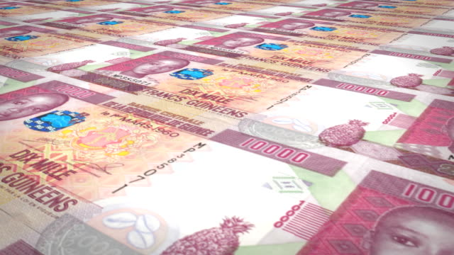 Banknotes of ten thousand guinean francs rolling, cash money, loop video
