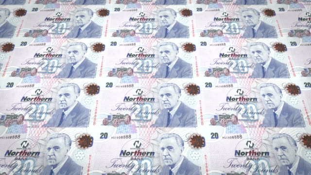 Banknotes of twenty pounds of Northern Ireland rolling, cash money video