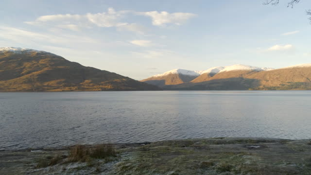 banks of a scottish loch in fall - fort william video stock e b–roll