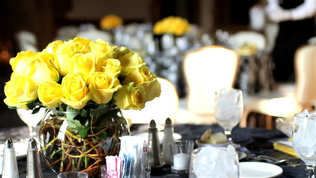 Banquet hall, restaurant. Waiter serving table prior ceremony, event. video