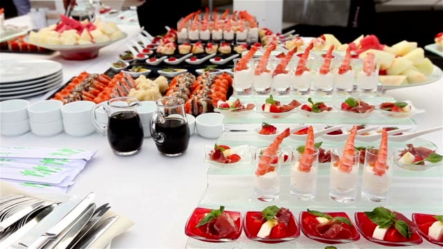 Banquet table with Chinese food, rolls, fish, sashimi, new year 2018, Table full of food, panorama, christmas, wedding, table full of food video