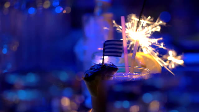 Bar cocktails with sparkler and Greek flag video