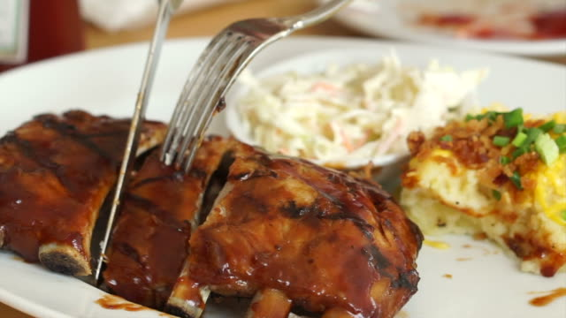 Barbecue baby pork ribs spare with with juicy sauce coleslaw and mashed potatoes video