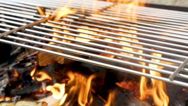 Barbecue grill fire in slow motion. video
