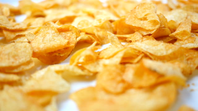 Barbecue Potato Chips rotating over white background - Alt Angle video