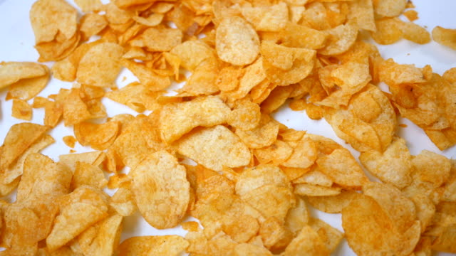 Barbecue Potato Chips rotating over white background - Overhead Angle video
