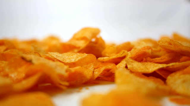 Barbecue Potato Chips rotating over white background - Shallow Depth of Field video