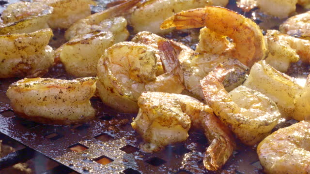 Barbecue Shrimp on a Charcoal Grill with flames