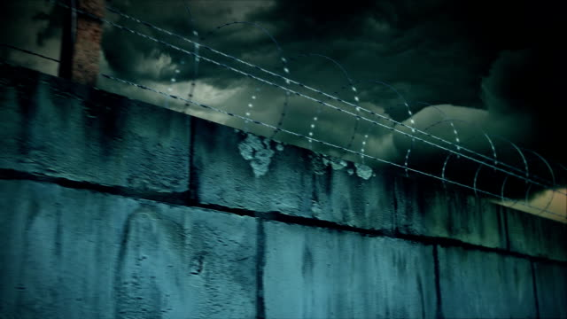 Barbed wire and concrete wall video