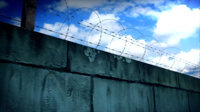 Barbed wire and concrete wall. video