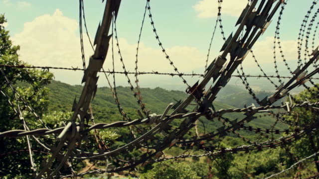 Barbed wire blocking beautiful nature. video