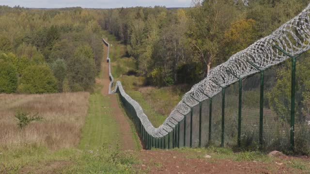 barbed wire fence on the state border