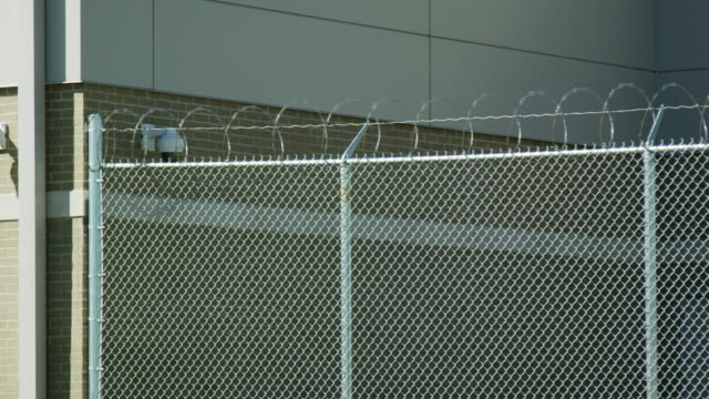 Barbed Wire Fence Prison Shot on Red Helium military private stock videos & royalty-free footage