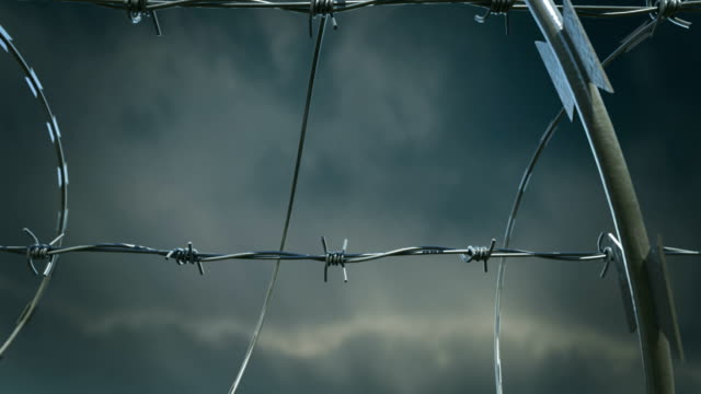 Barbed wire fence. Radioactive sign.HD video