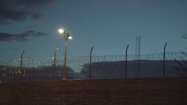 Barbed Wire Fencing at Dusk Surrounding the United States Penitentiary, Administrative Maximum Facility Supermax Prison Complex in Florence, Colorado (Fremont County) - the