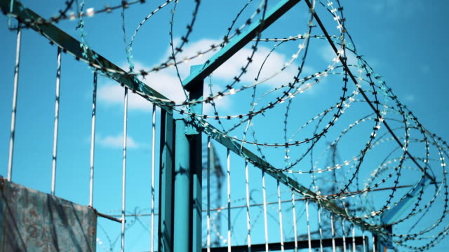Barbed wire on the fence. no entry. Protected area video
