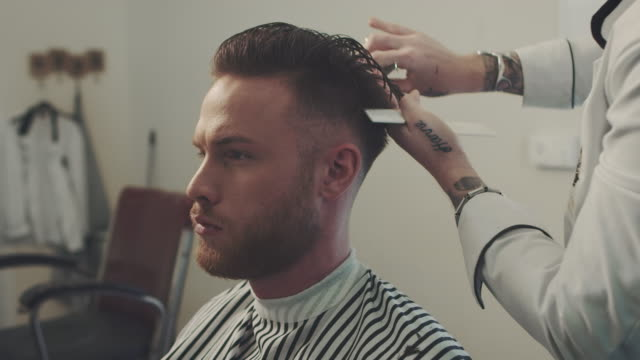 barber cutting a mans hair - beauty salon stock videos and b-roll footage