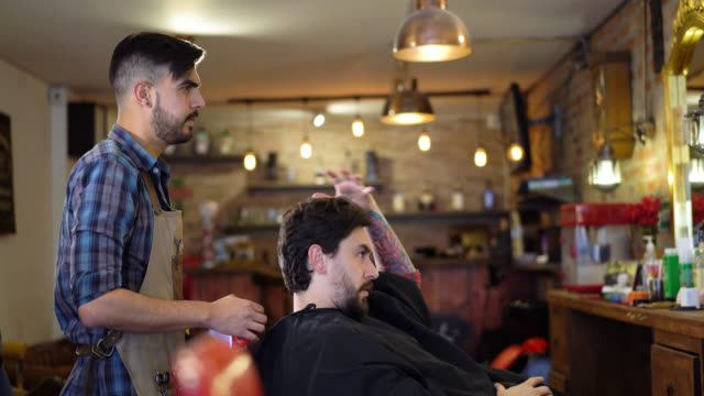 Barber listening clients request for his beard and haircut video