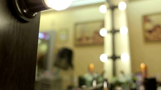 Barber mirror with lamps and three make-up brushes video