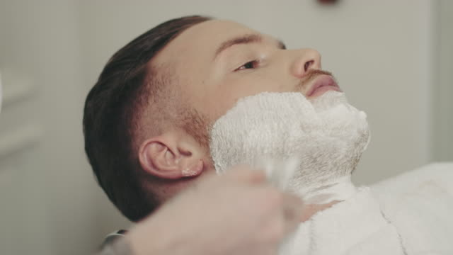 Barber preparing beard video