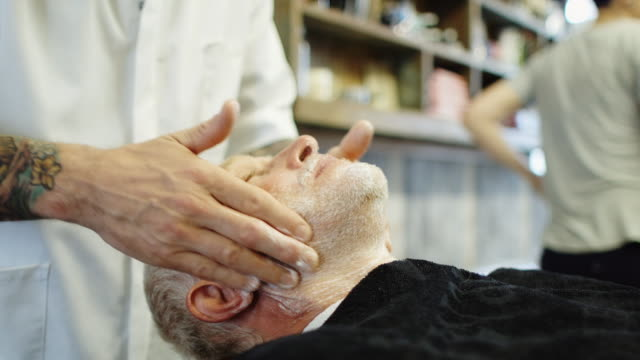 Barber Rubbing Client's Face video