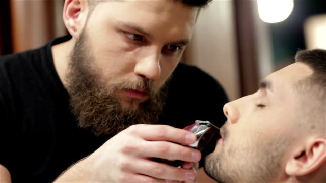 Barber shave and modeling beard at the hair salon video