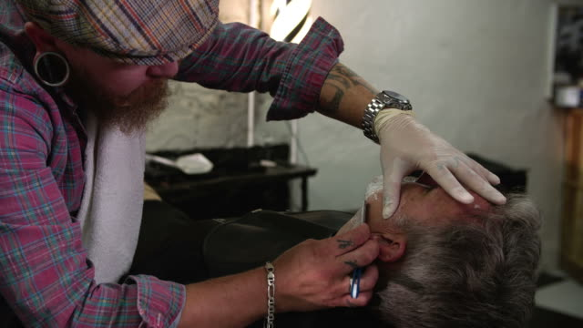 Barber Shaving Client With Cut Throat Razor video