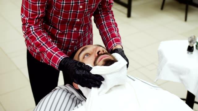 Barber towel wipes his beard video