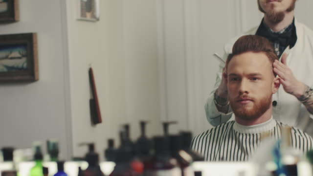 Barber using hair grease video