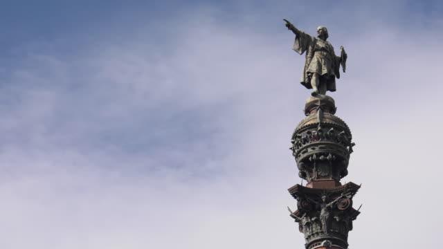 barcelona spain view of mirador de colom against blue sky - columbus day filmów i materiałów b-roll