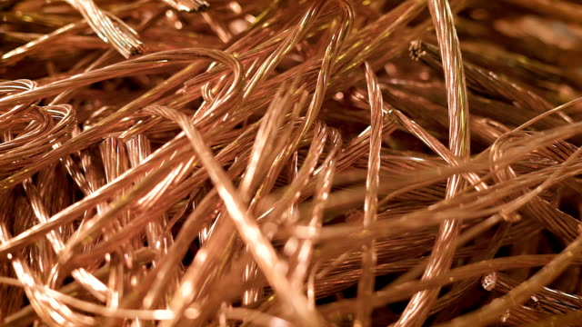 bare wires of copper cables are lying in a heap of scrap metal in factory premise, close-up shot bare wires of copper cables are lying in a heap of scrap metal in factory premise, close-up shot, copper scrap from wires copper stock videos & royalty-free footage