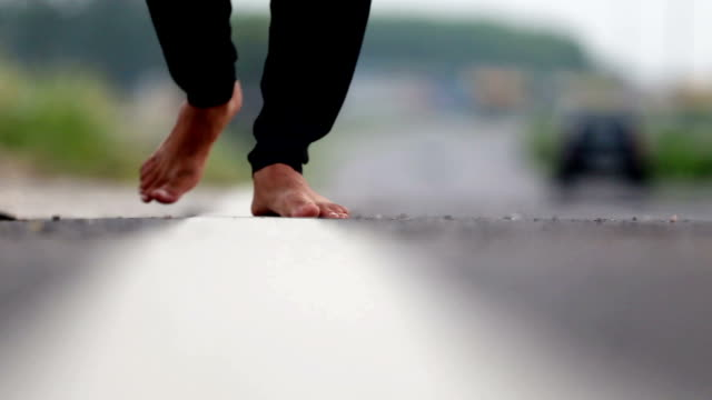 Barefoot footsteps walking close up video