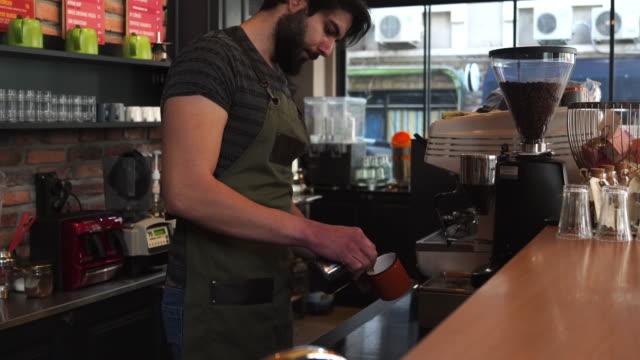 Barista brewing espresso at cafe