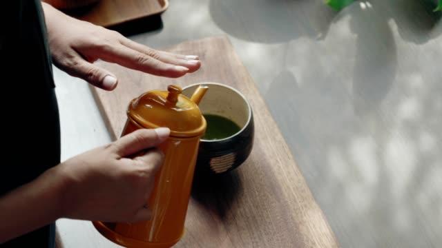 Barista doing hot matcha tea video