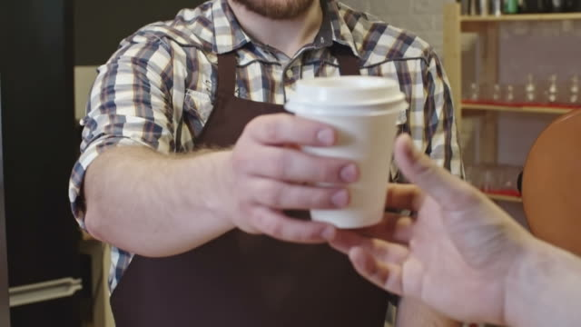 Barista Giving Coffee to Client video
