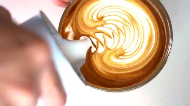 SLO MO Barista hand making latte art coffee. SLO MO CS Full HD Barista hand making latte art coffee. coffee stock videos & royalty-free footage